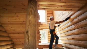 general laborer working on cabin construction